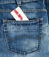 back pocket of jeans and a white price tag with the inscription