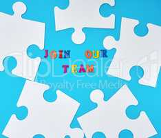 paper blank white puzzle on a blue background, the inscription j