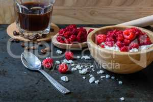 Cottage cheese with raspberries and cup of coffee for breakfast