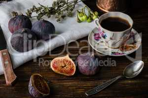 Seasonal and exotic fig with coffee cup for breakfast