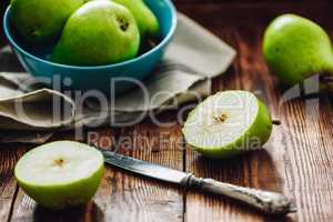 Sliced Pear with Knife.
