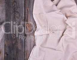 textile dishcloth on a gray wooden background from old boards