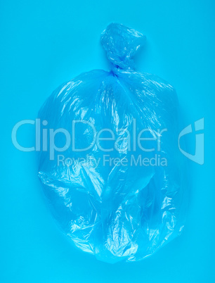 blue plastic bag for garbage on a blue background