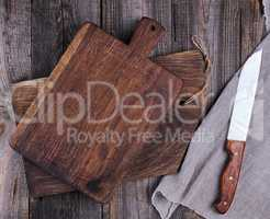 two old wooden cutting boards and a knife