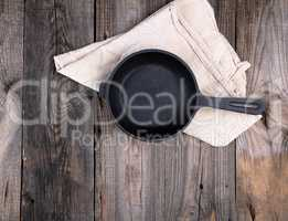 empty black round frying pan with  handle