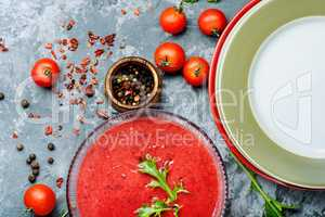 Tomato soup on stone background