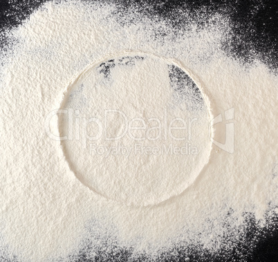 sprinkled white flour, round imprint from sieve