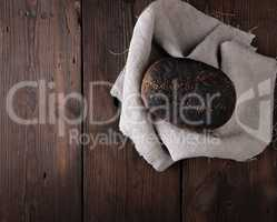 baked rye bread on a gray linen napkin