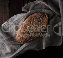 baked oval bread made from rye flour with pumpkin seeds