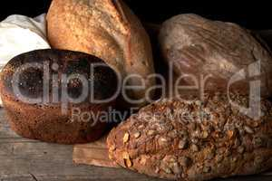 whole baked rye bread with pumpkin seeds and other types