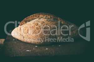 Baked white wheat flour oval crispbread on a wooden board