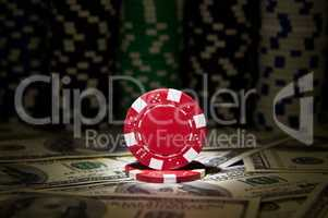 Red poker Chip at dollar background;