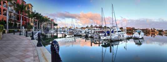 Sunrise over the boats in Esplanade Harbor Marina in Marco Islan