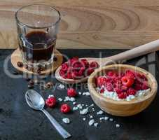Cottage cheese with raspberries and cup of coffee