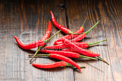 Pile of Mexican chili peppers on wooden background