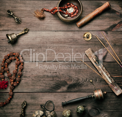 Copper singing bowl, prayer beads, prayer drum and other Tibetan