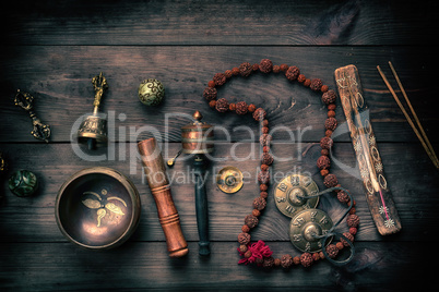 Copper singing bowl, prayer beads, prayer drum and other Tibetan