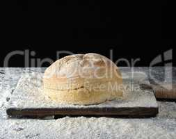 round baked bread and white wheat flour