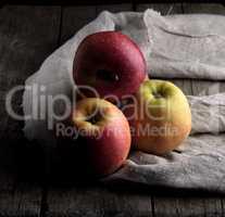 fresh red apples lies on a gray linen napkin
