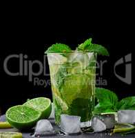 cold drink of fresh lemons, lime, mint green and ice cubes in a