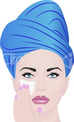 A girl using  facial  cream for skincare