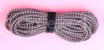 brown Aux Stereo Audio Cable on pink background