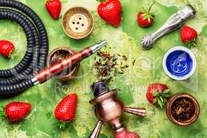 Smoking shisha on strawberry