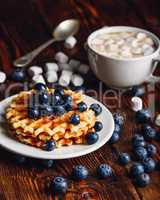 Waffles with Blueberry and Cup of Cocoa.