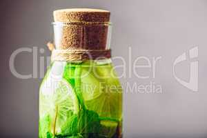 Bottle with Water Flavored with Lime and Mint.