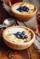 Two Bowl of Granola with Banana and Blueberry.