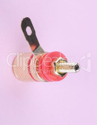 Speaker connector on pink background