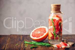 Bottle of Water with Grapefruit and Rosemary.