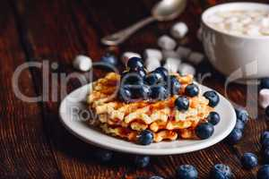 Waffles with Blueberry and Syrup.