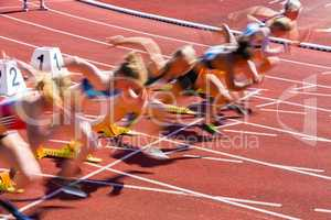 blurred dynamic start of sprint in athletics