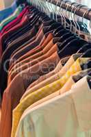 Male Mens Shirts on Hangers on a Shop Wardrobe Closet Rail