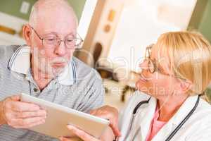 Female Doctor or Nurse Showing Senior Man Touch Pad Computer