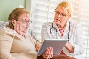 Doctor or Nurse Talking to Senior Woman with Touch Pad Computer