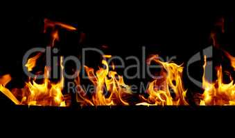 bright orange and yellow flames on a black background,close up