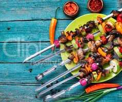 Vegan skewers on wooden background