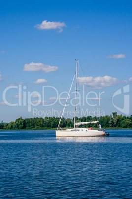 White Sailing Boat on the River.