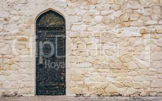 Stone Wall with Door and Oriental Engraving.