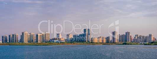 Urban landscape on river bank.