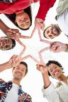 Business people forming star shape with their fingers in a modern office