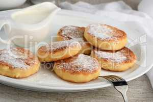 Breakfast. Cheese pancakes with sour cream