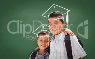 Young Hispanic Student Boys Wearing Backpack Front Of Chalk Board
