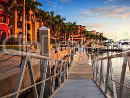 Sunset over the boats in Esplanade Harbor Marina in Marco Island
