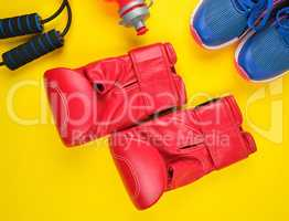 pair of red boxing gloves and blue sneakers