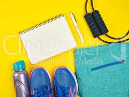 open empty notebook and sports women's clothing for sports and f