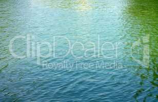 ripple on water in city park pond
