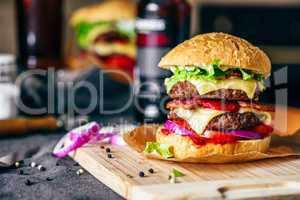 Cheeseburger on Cutting Board with Bottle of Beer